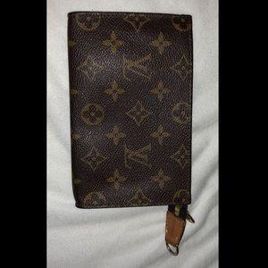 Louis Vuitton coin purse.